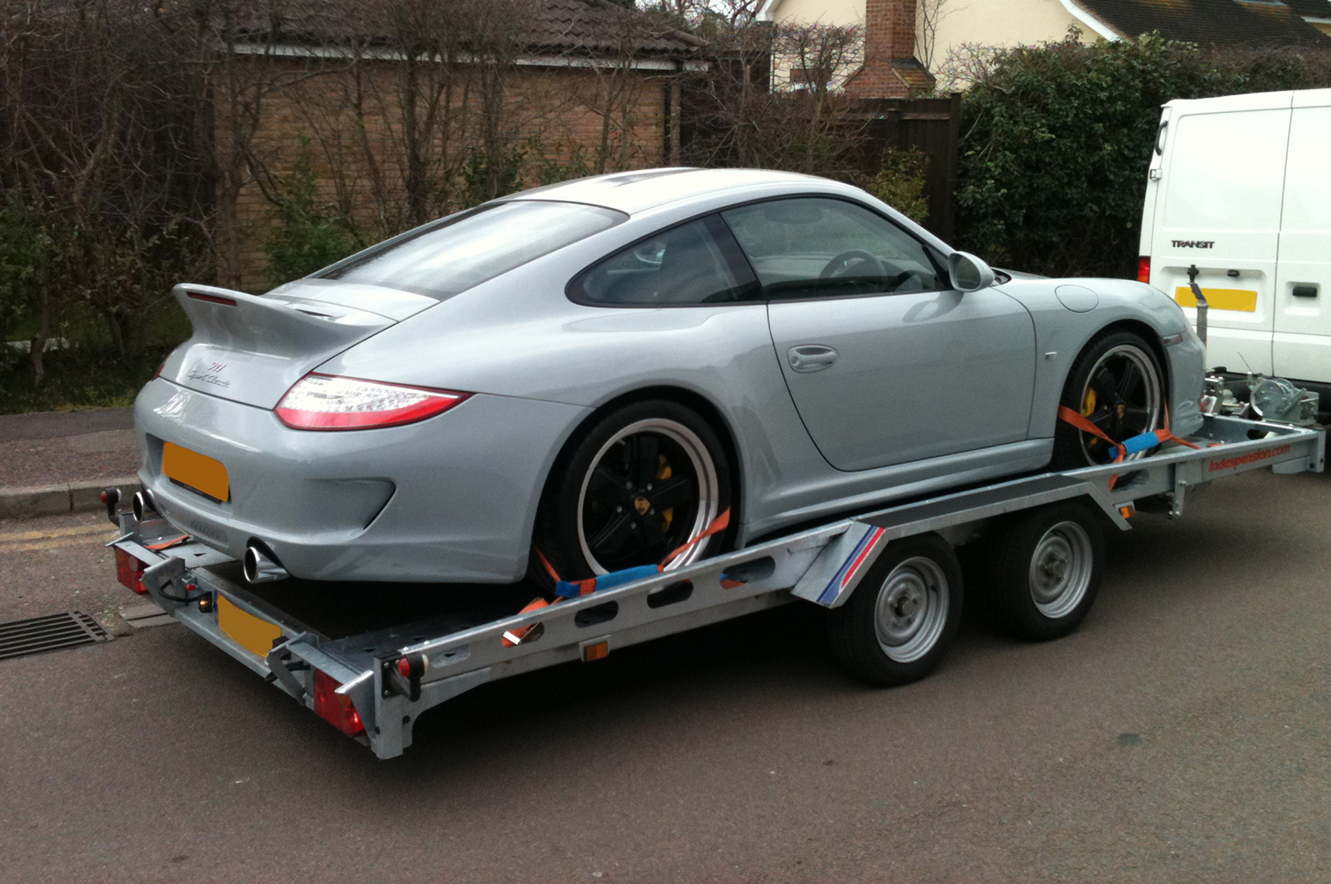 Porsche 911 being transported to event