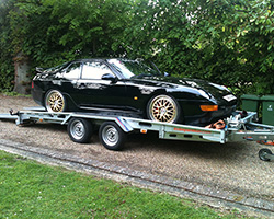 Sports car being transported. Vehicle recovery