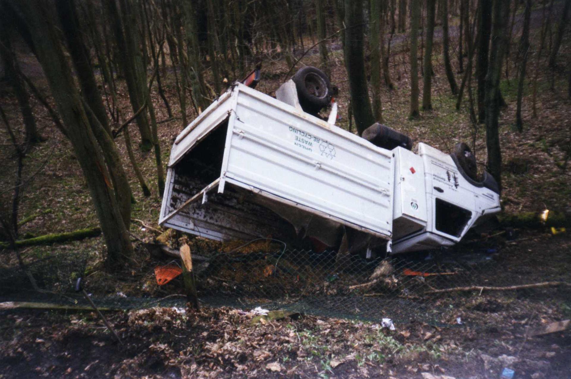 Truck crashed down embankment